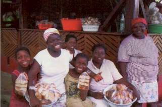 Garifuna Ladies Selling Coconut Bread on Roatan Honduras